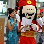 That's me right beside the mascot Tsai Shen Yeh - the Chinese God of Money.