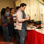 bloggers lined-up on the buffet table