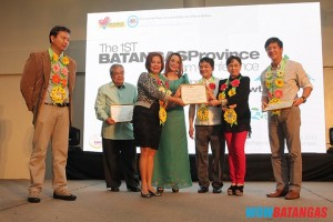 Receiving the certificate of recognition from Gov. Vi is Thelma Dumpit-Murillo